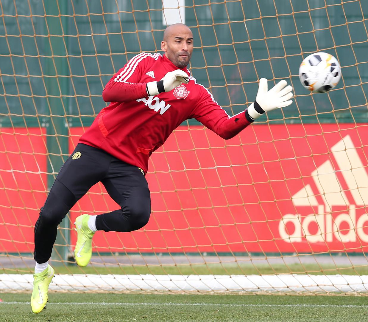 Lee Grant saves a shot in training.