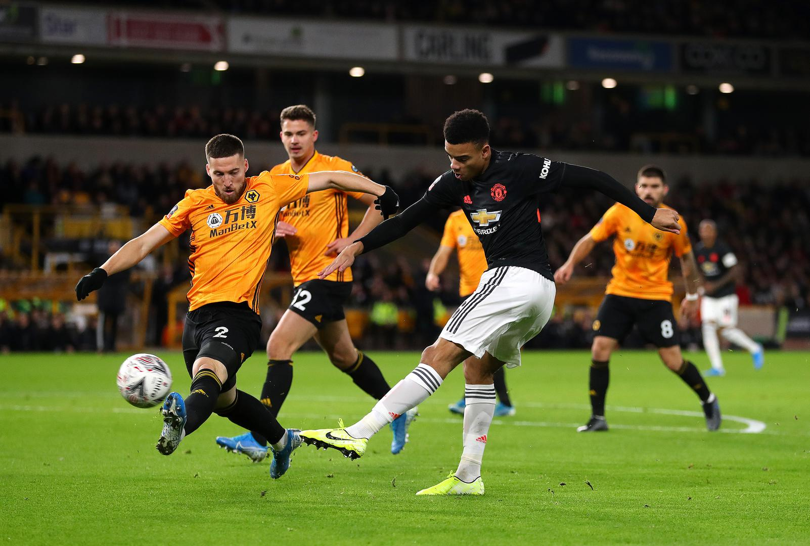 Mason Greenwood shoots for goal at Molineux..