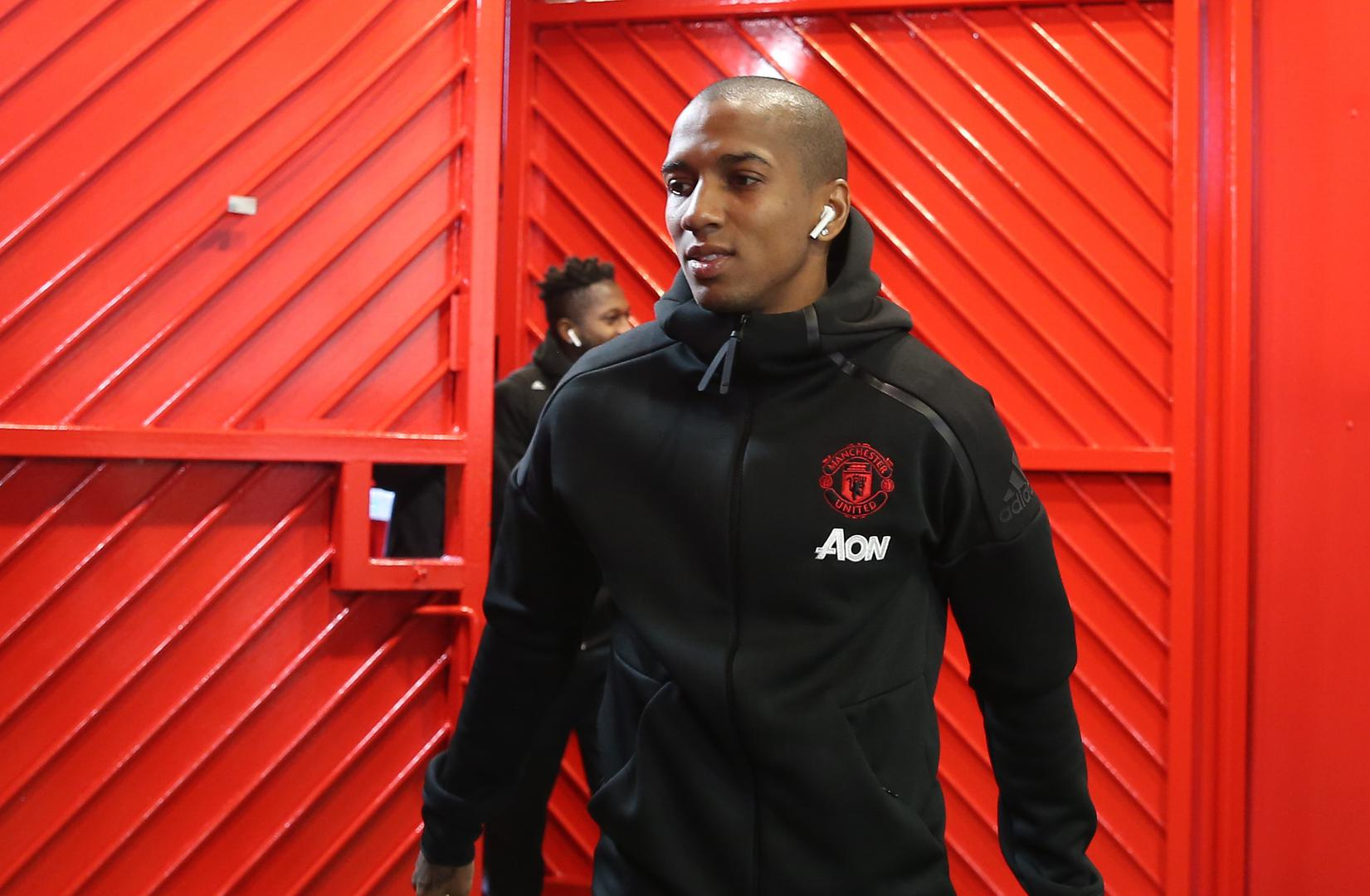 Ashley Young entering Old Trafford before a match.