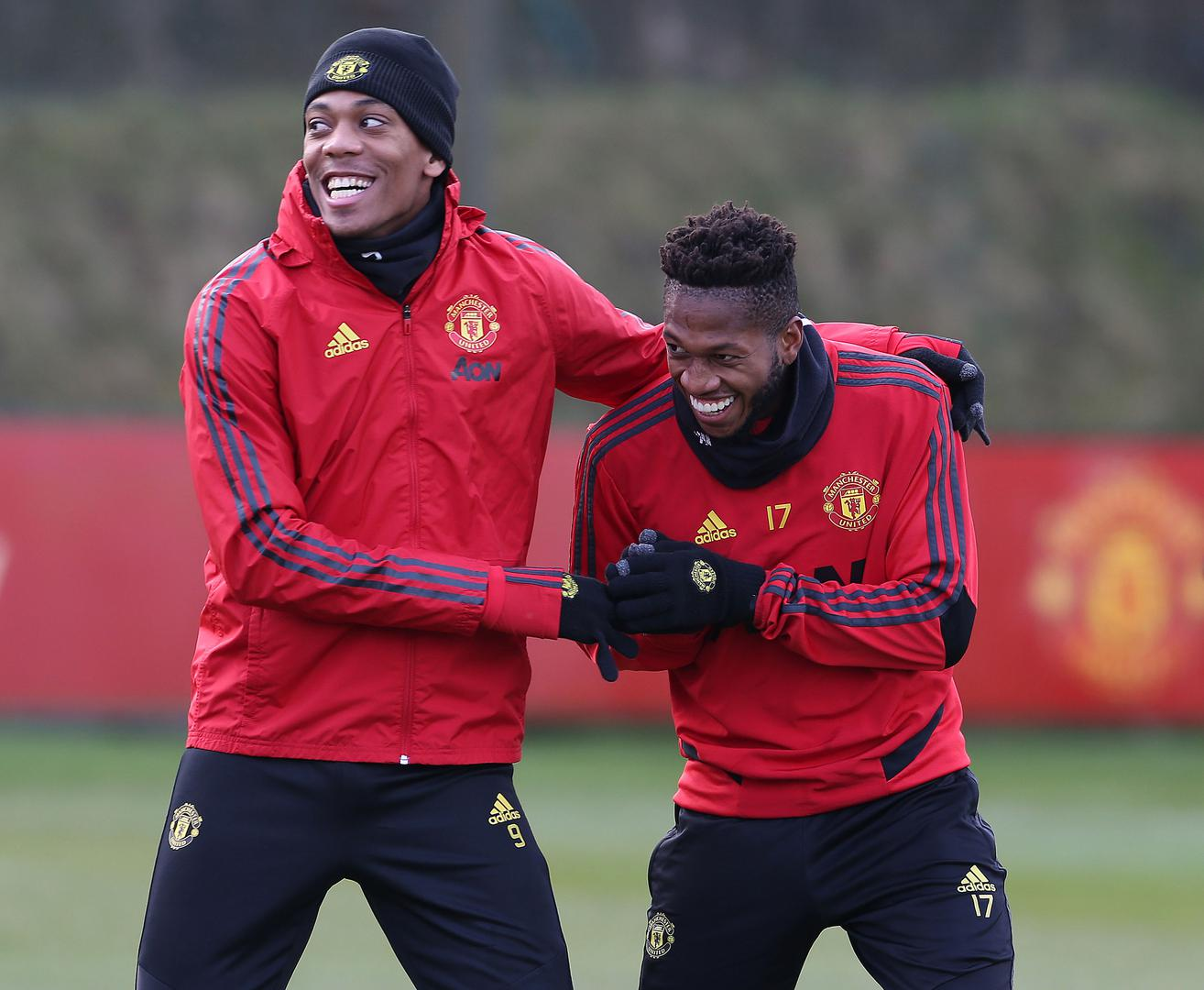 Anthony Martial and Fred are all smiles at the Aon Training Complex