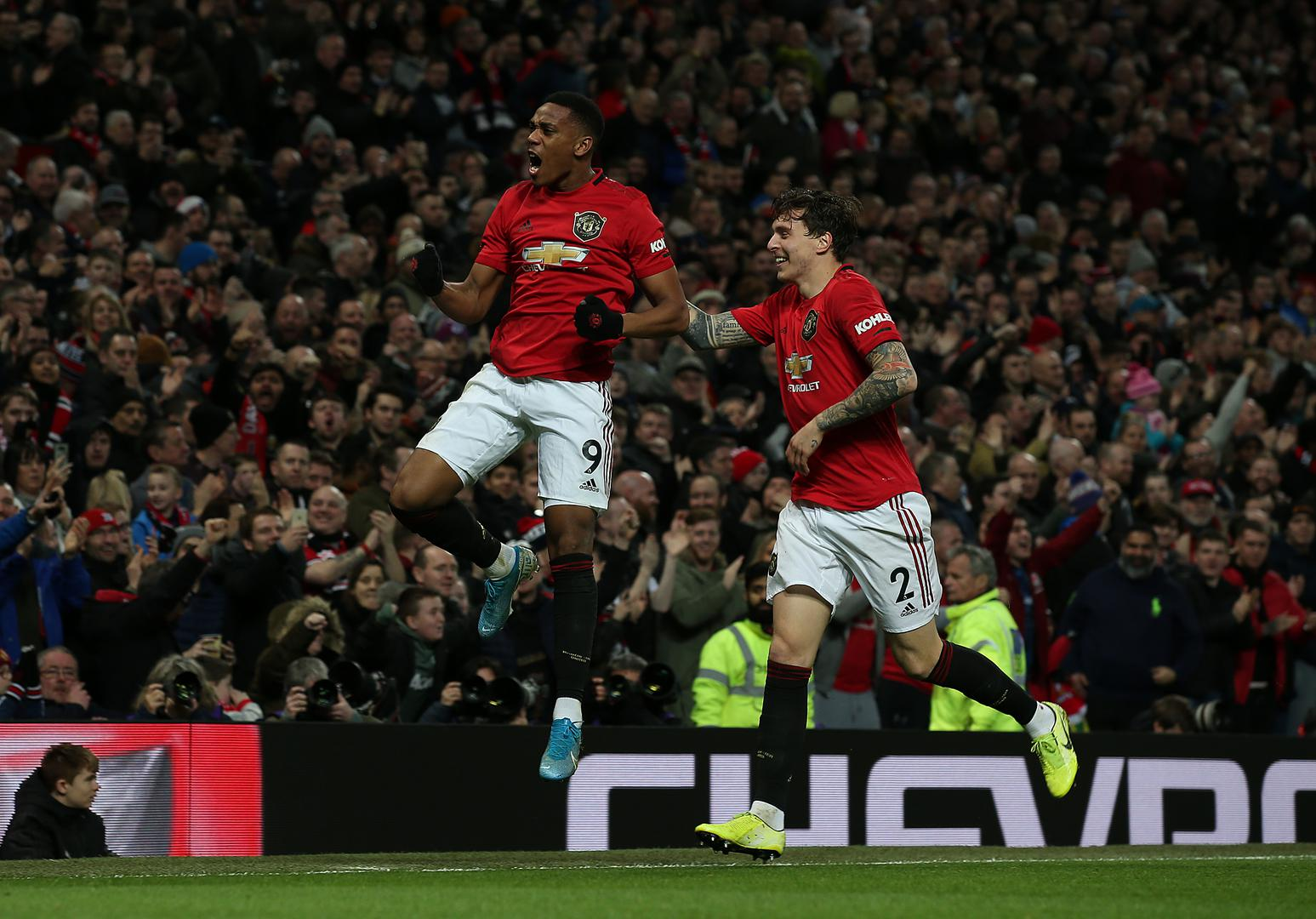 Martial and Lindelof celebrate.