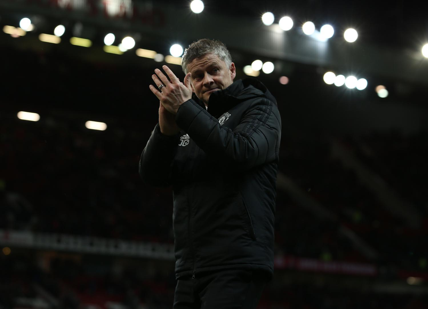 Ole Gunnar Solskjaer applauds the crowd.