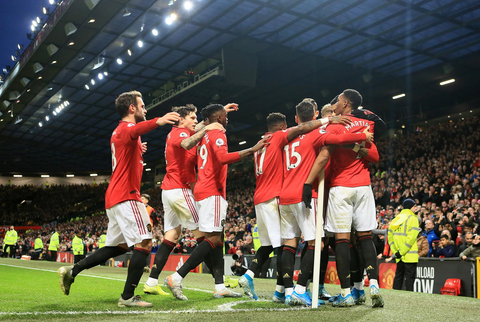 Manchester United players celebrate scoring against Norwich City.