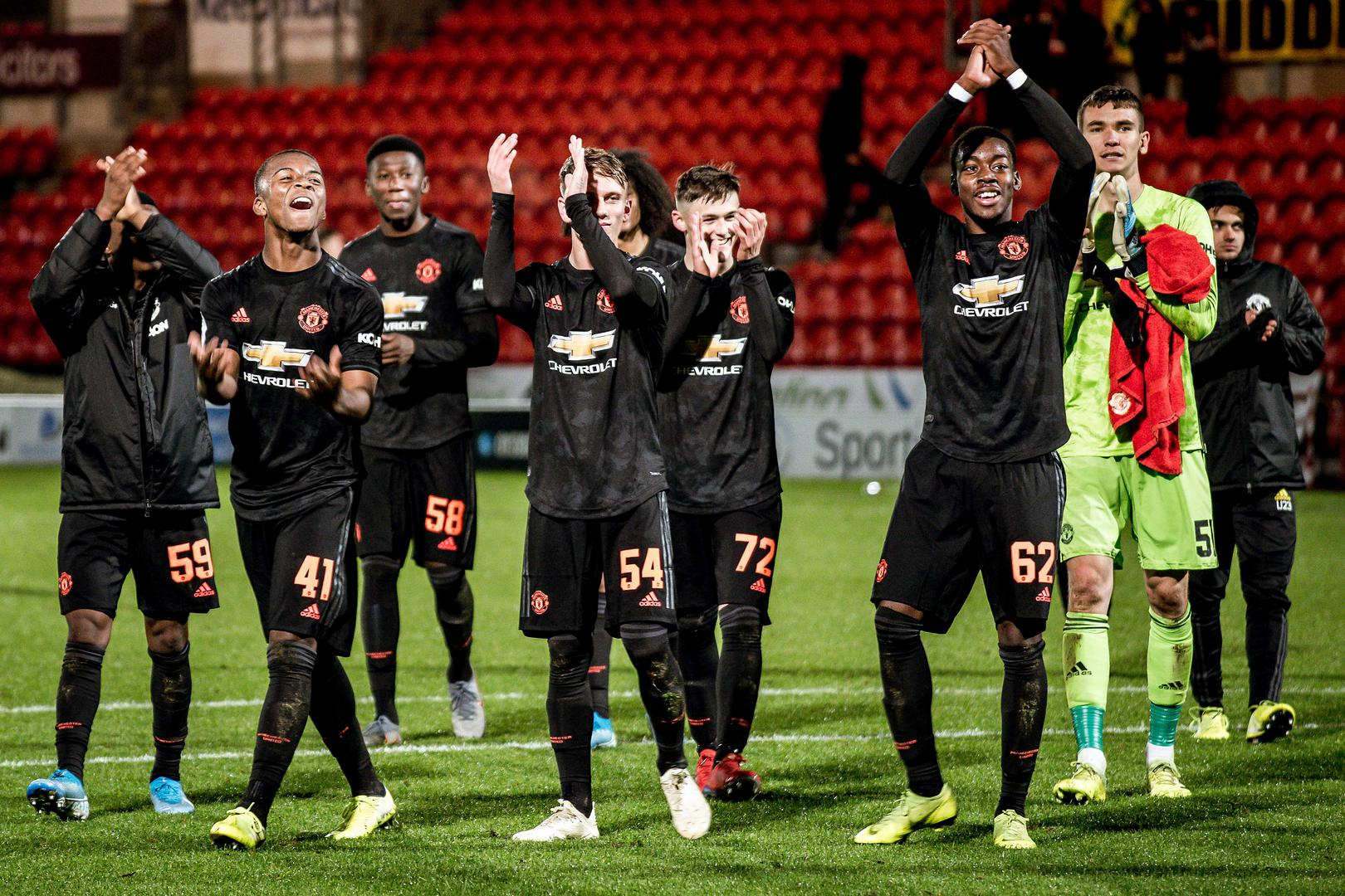 United's Under-23s celebrate a win at Doncaster.,