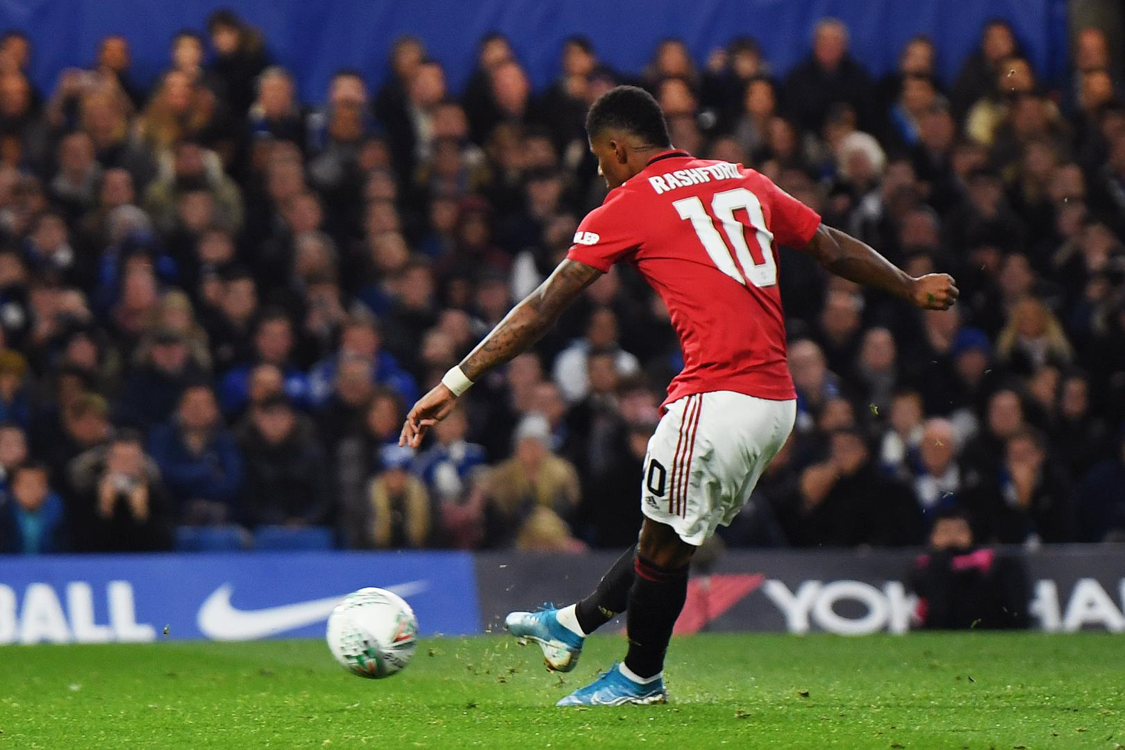 Marcus Rashford scores for Manchester United against Chelsea.
