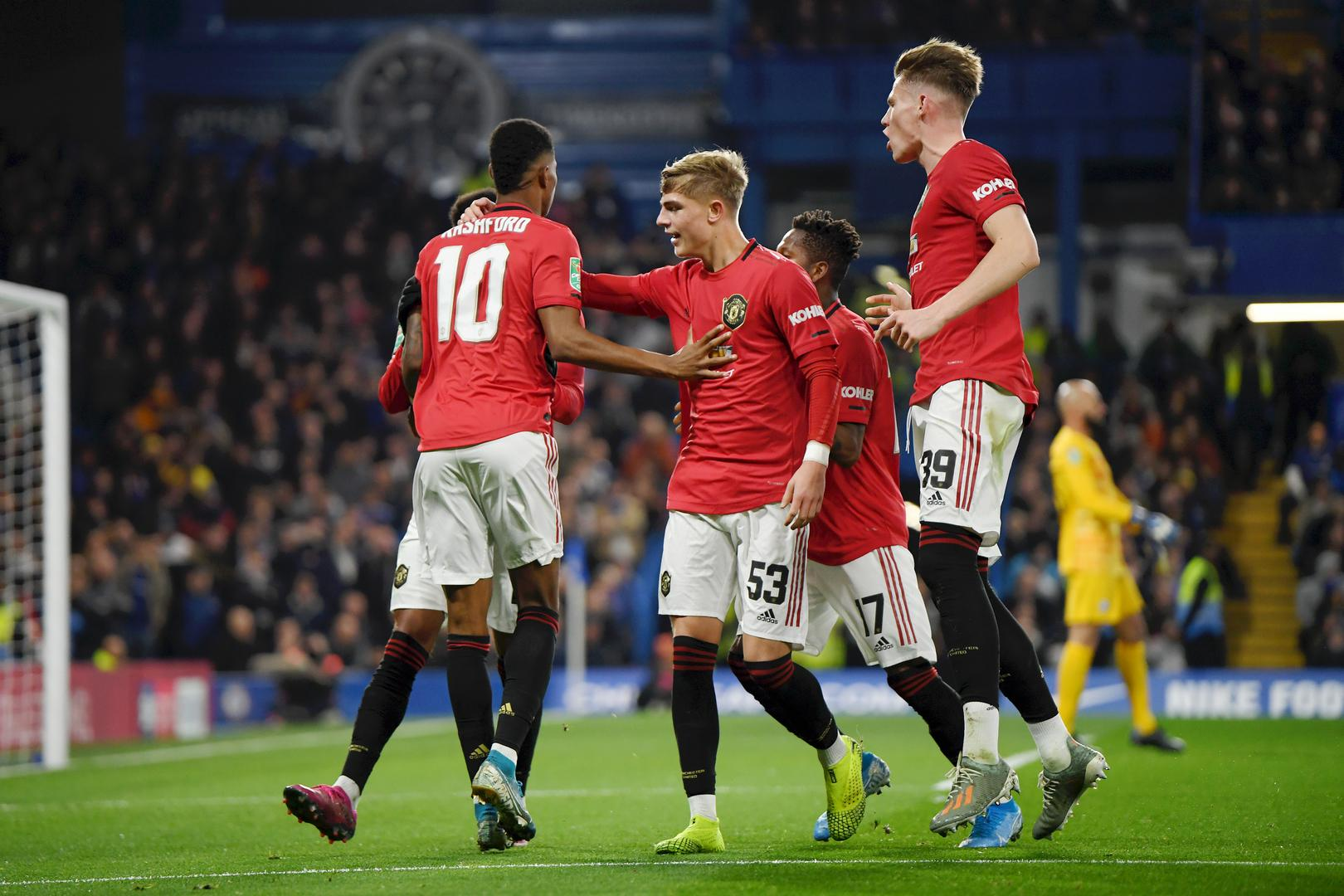 Brandon Williams and Scott McTominay help to celebrate one of Marcus Rashford's goals against Chelsea,