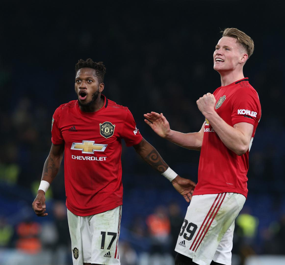 Fred and Scott McTominay react to Marcus Rashford's free-kick at Chelsea