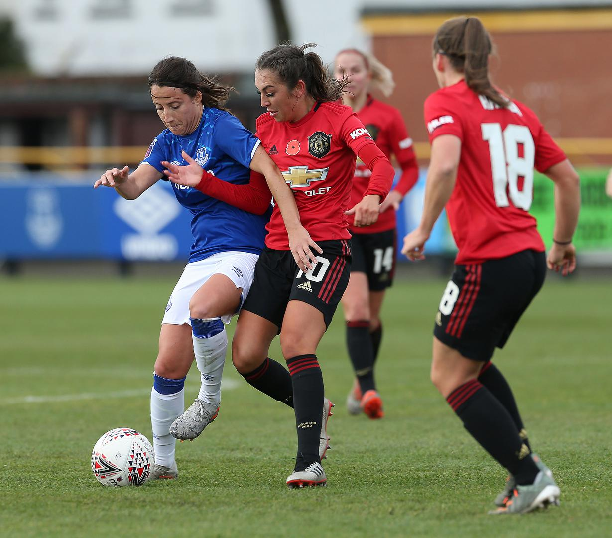 Katie Zelem competes for the ball during Manchester United Women v Everton.