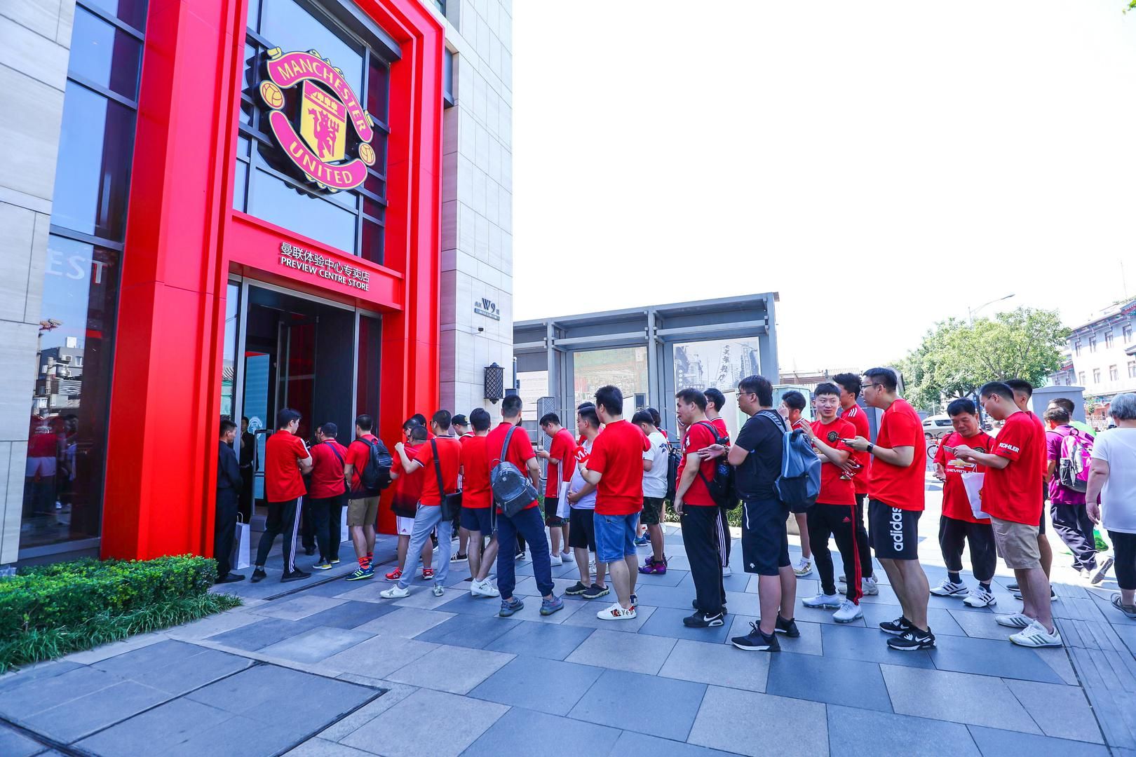Fans queue up outside MUX Experience Centre.