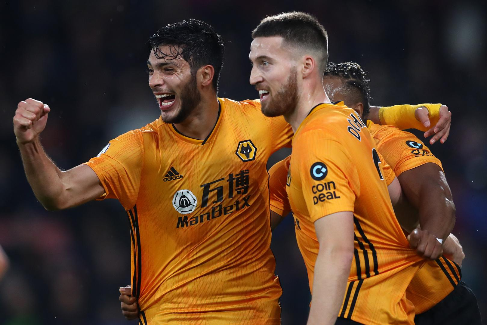 Wolverhampton Wanderers players celebrate scoring a goal.