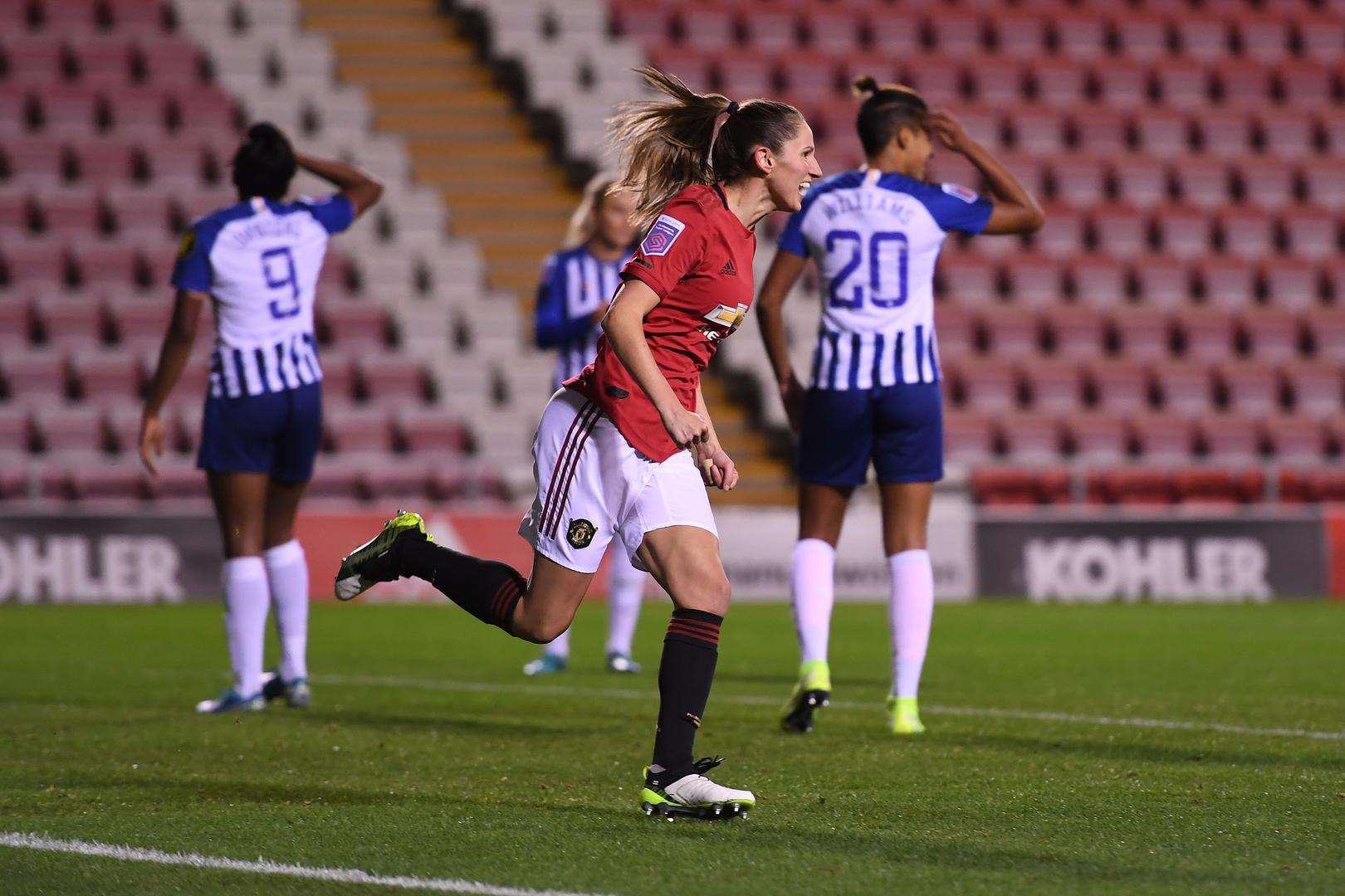 Abbie McManus celebrates scoring for Manchester United Women against Brighton & Hove Albion Women.