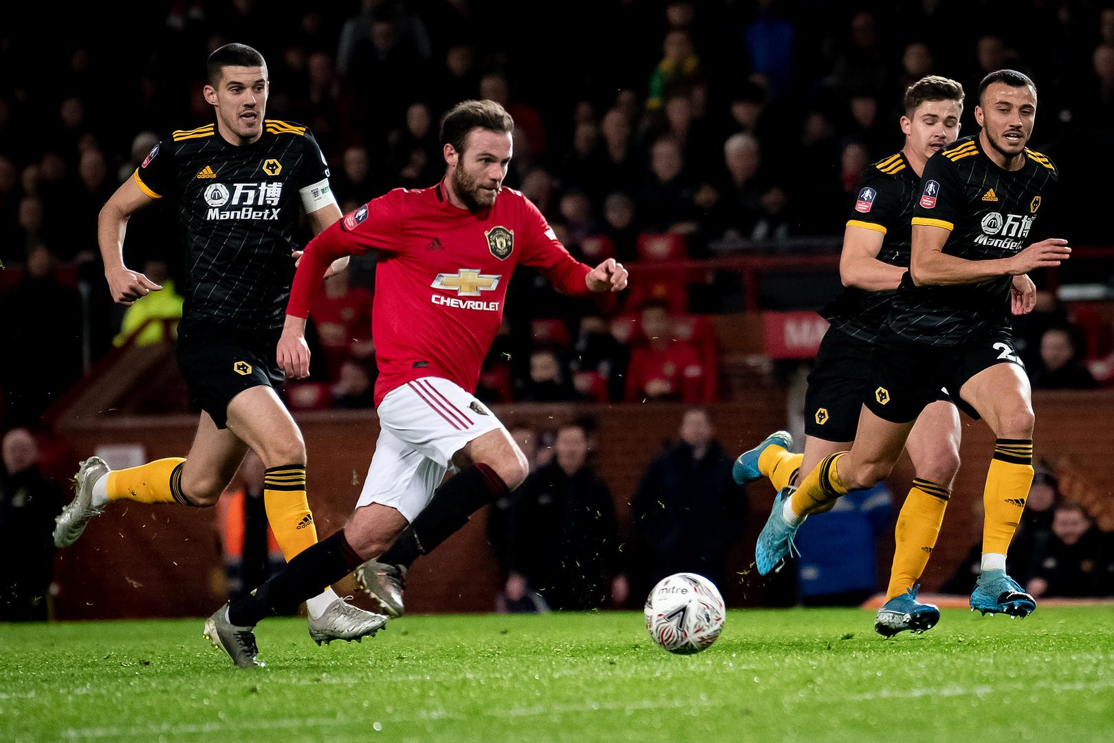 Juan Mata breaks into the Wolves penalty area to score Manchester United's winning goal
