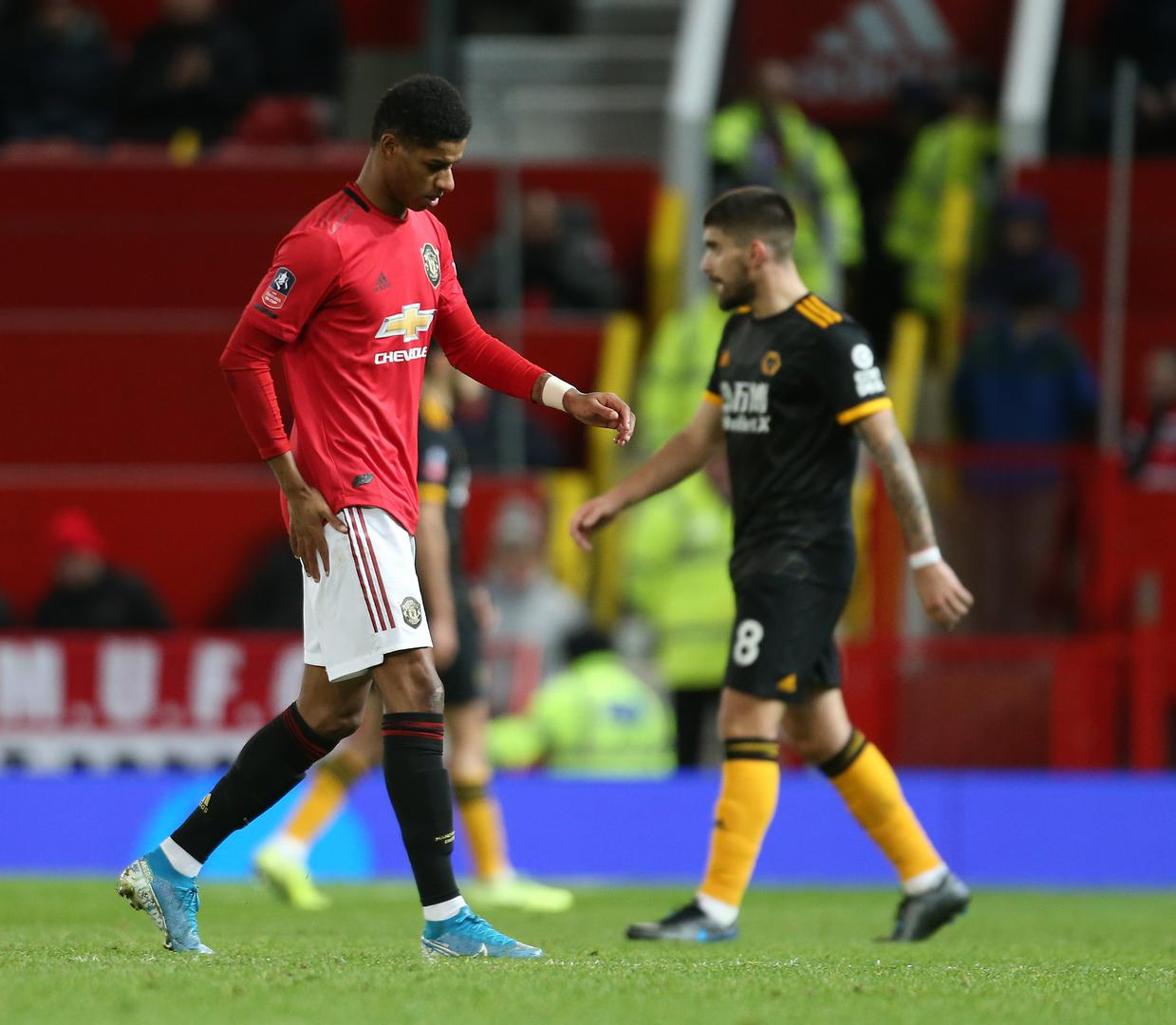 Marcus Rashford walks off against Wolves.