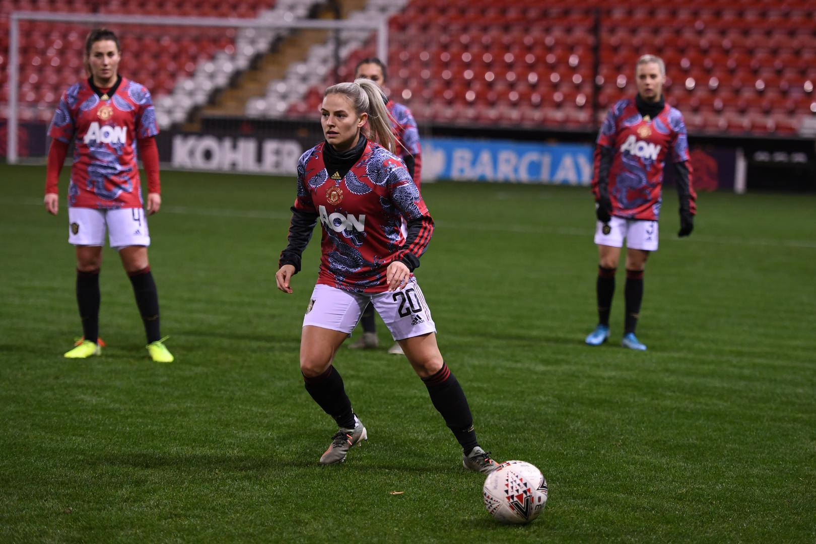 United Women players including Kirsty Smith warm up for a Continental League Cup game at Leigh Sports Village