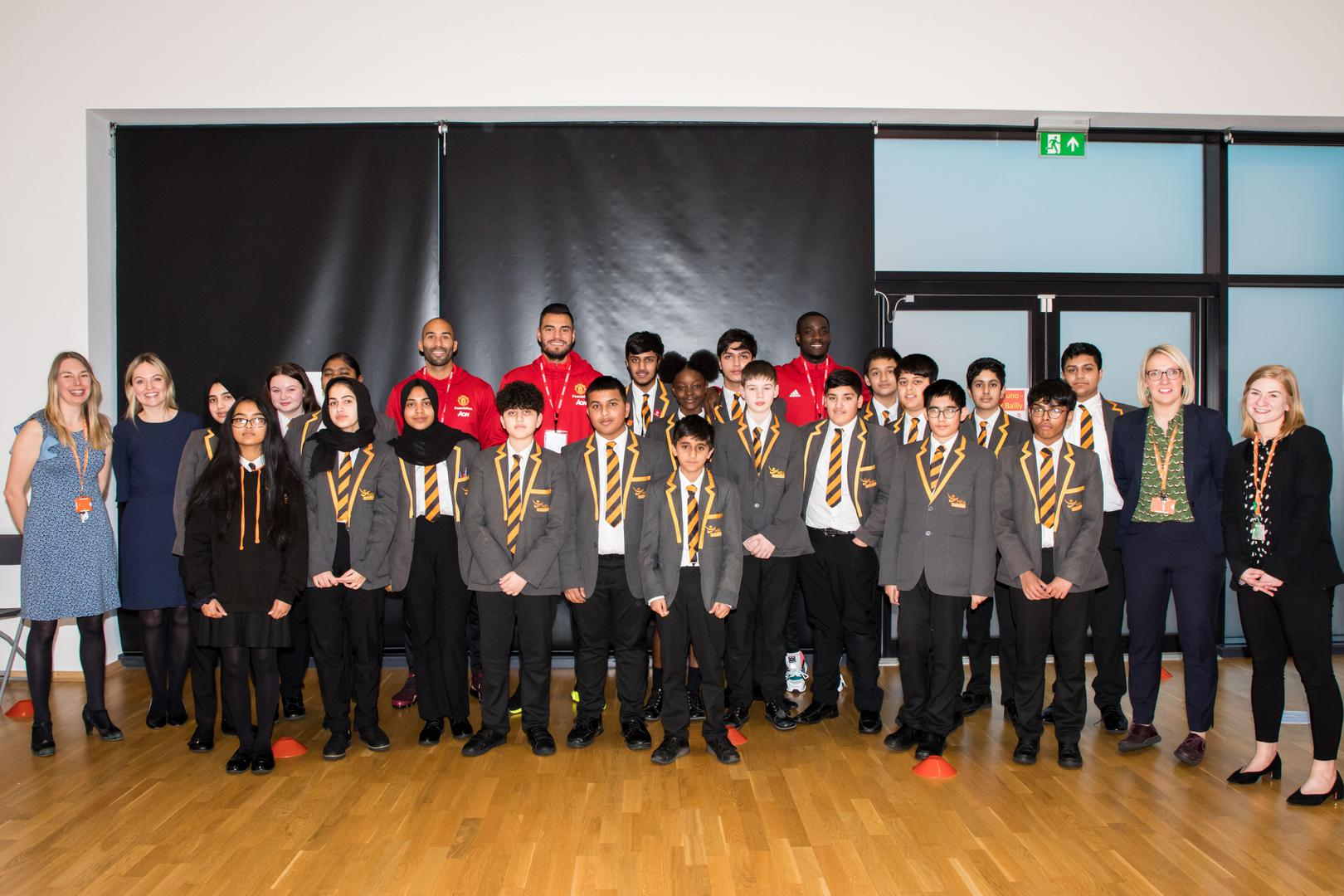 Grant, Bailly and Romero with pupils of MEA Central.