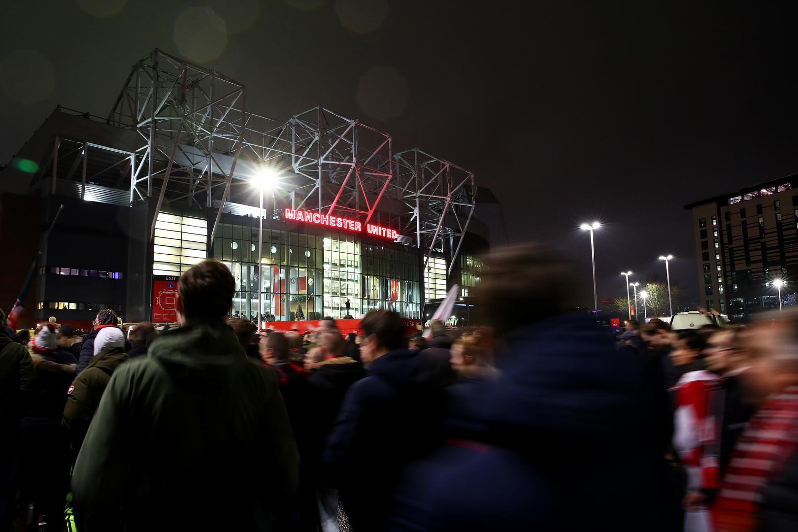 Manchester United fans arrive outside the East Stand of Old Trafford on a match night