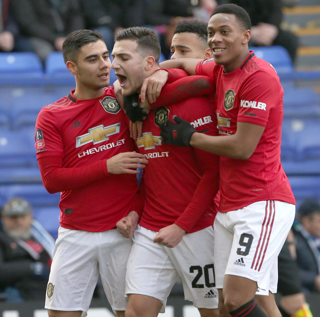 Diogo Dalot celebrates with Manchester United team-mates after scoring against Tranmere Rovers in the Emirates FA Cup