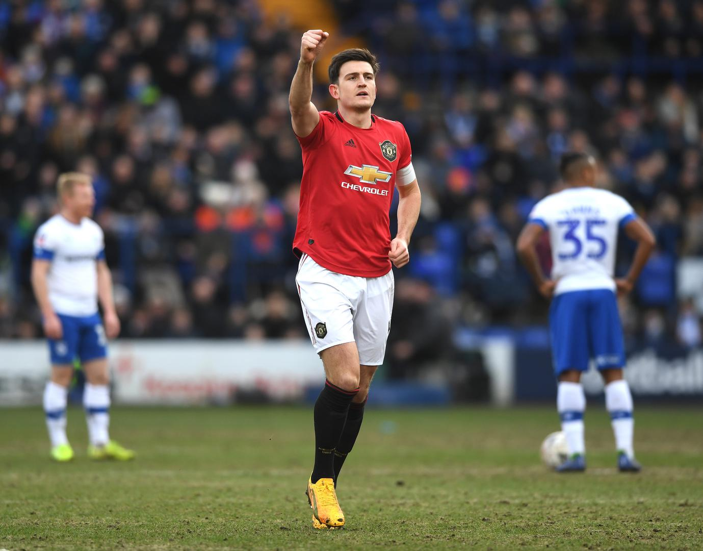 Harry Maguire holds his hand up in celebration against Tranmere.