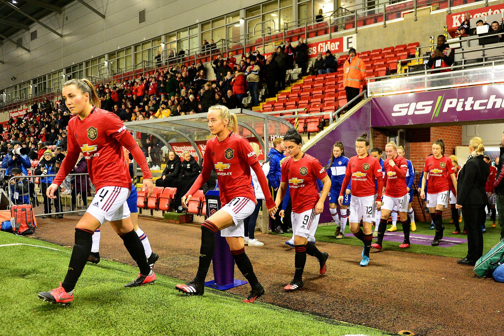 United Women players walk out at Leigh Sports Village.