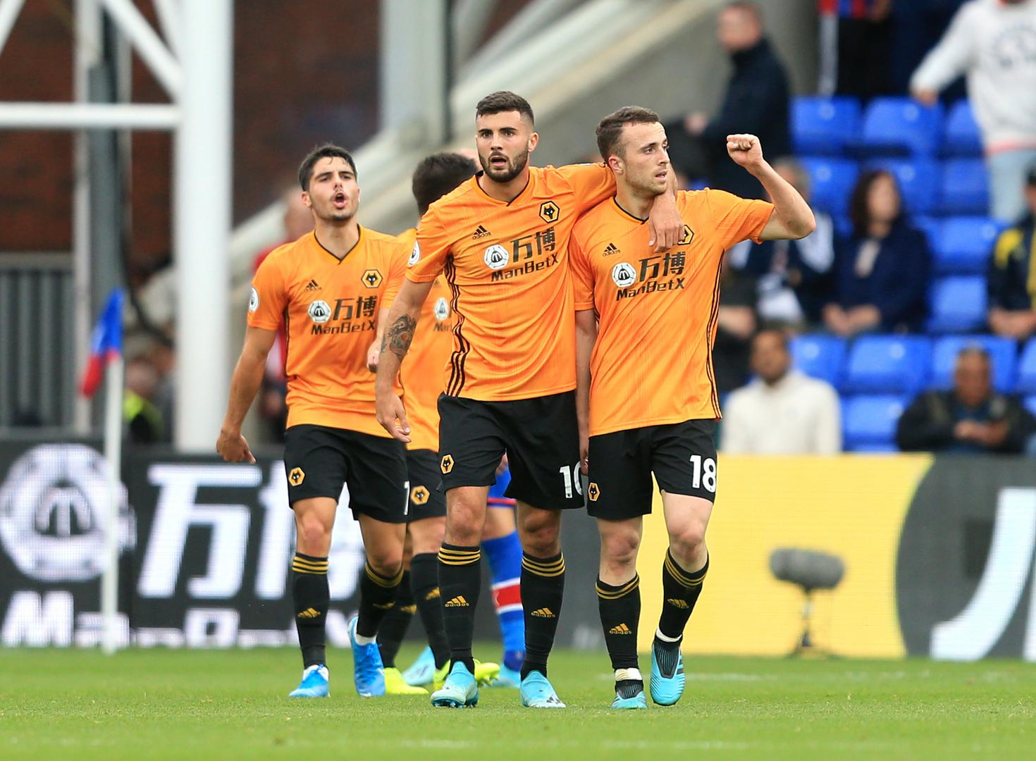 Patrick Cutrone and Diogo Jota celebrate scoring a goal for Wolverhampton Wanderers.