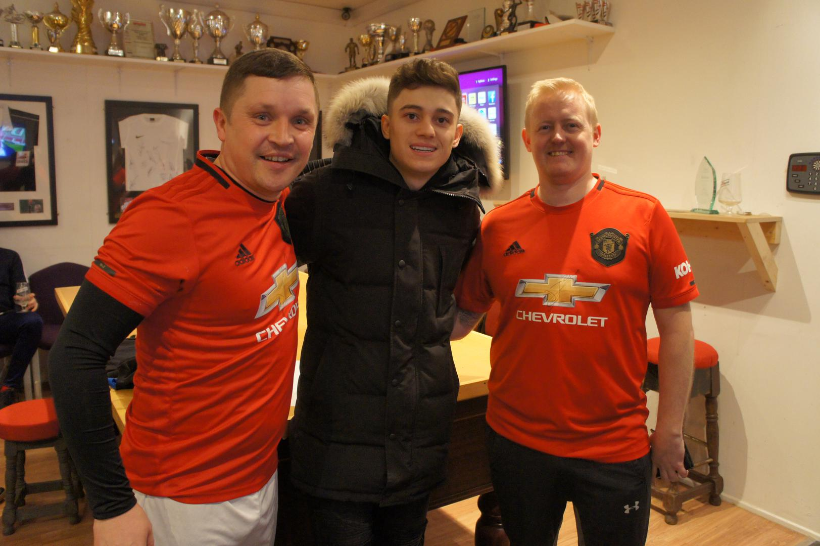 Daniel James with members of Place 2 Place FC on visit to Wigan.