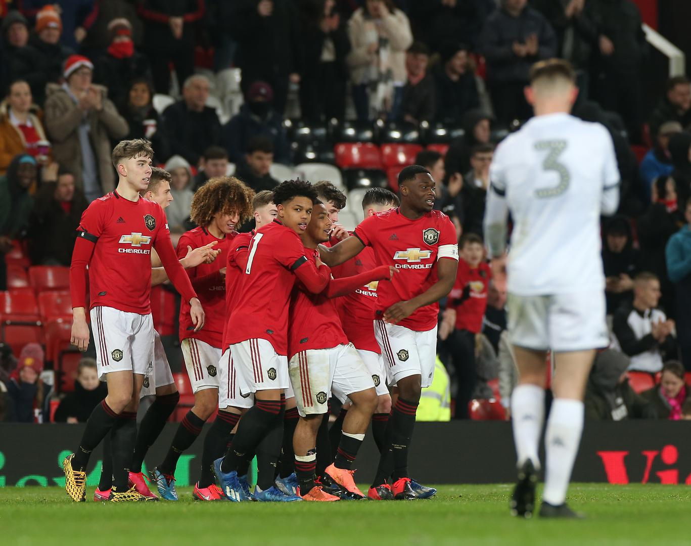 United celebrate against Leeds.