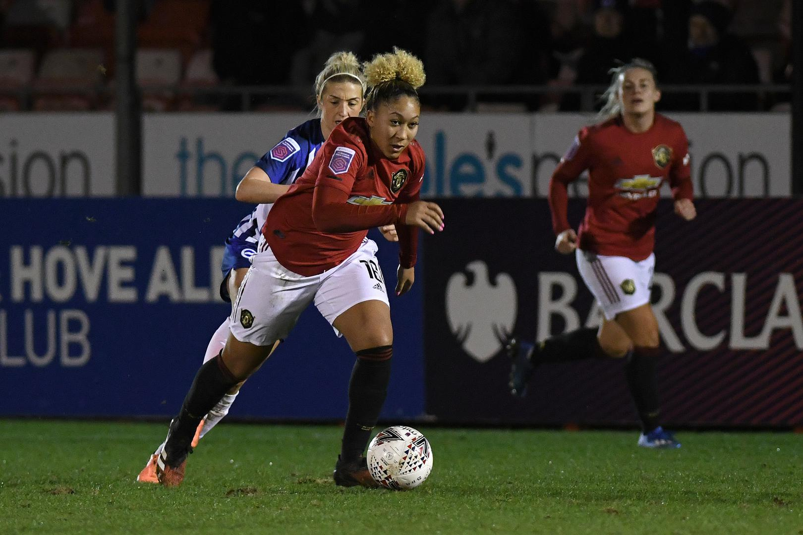 Lauren James on the ball for Manchester United in the Women's Super League against Brighton & Hove Albion