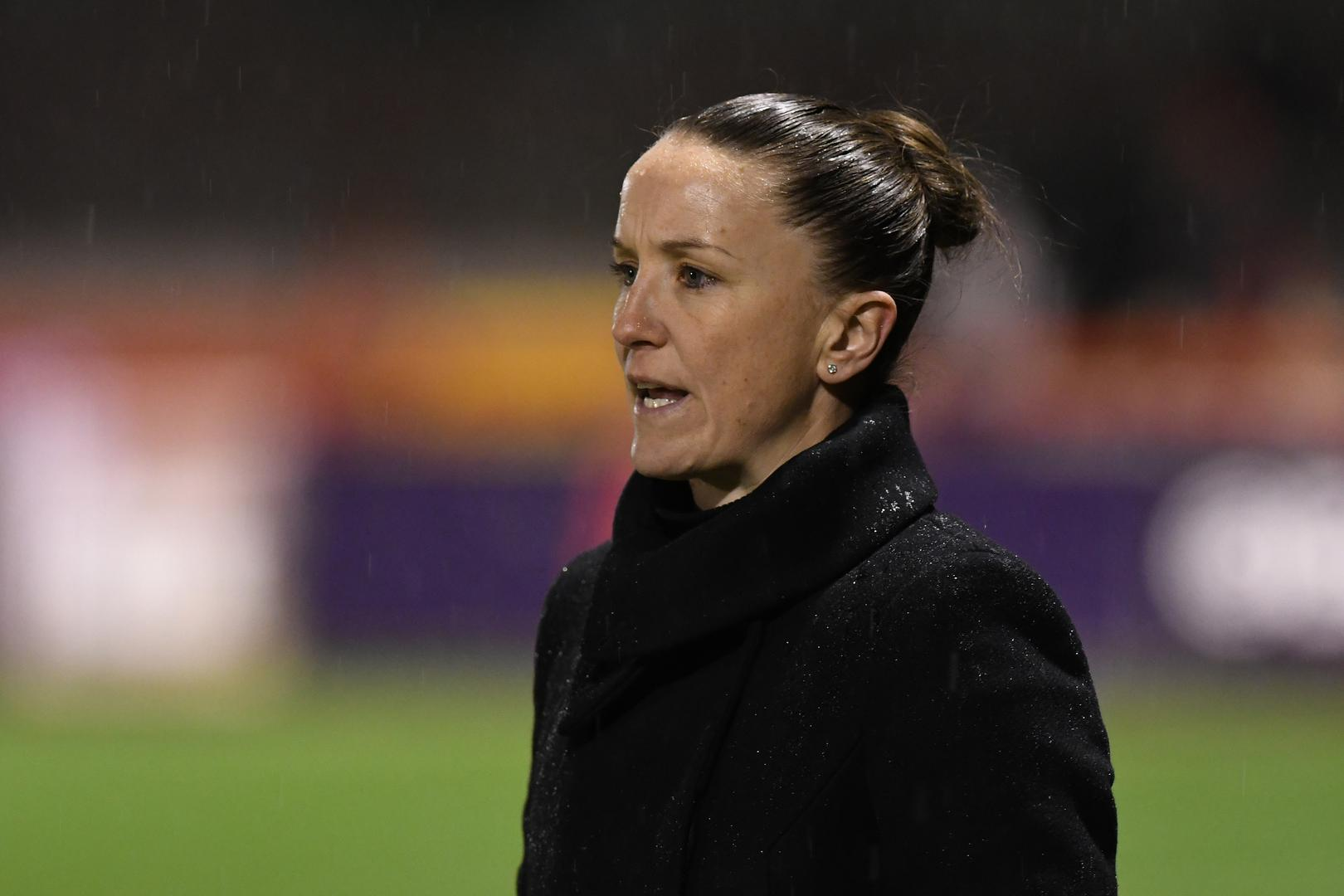 Casey Stoney watches on from the sidelines.