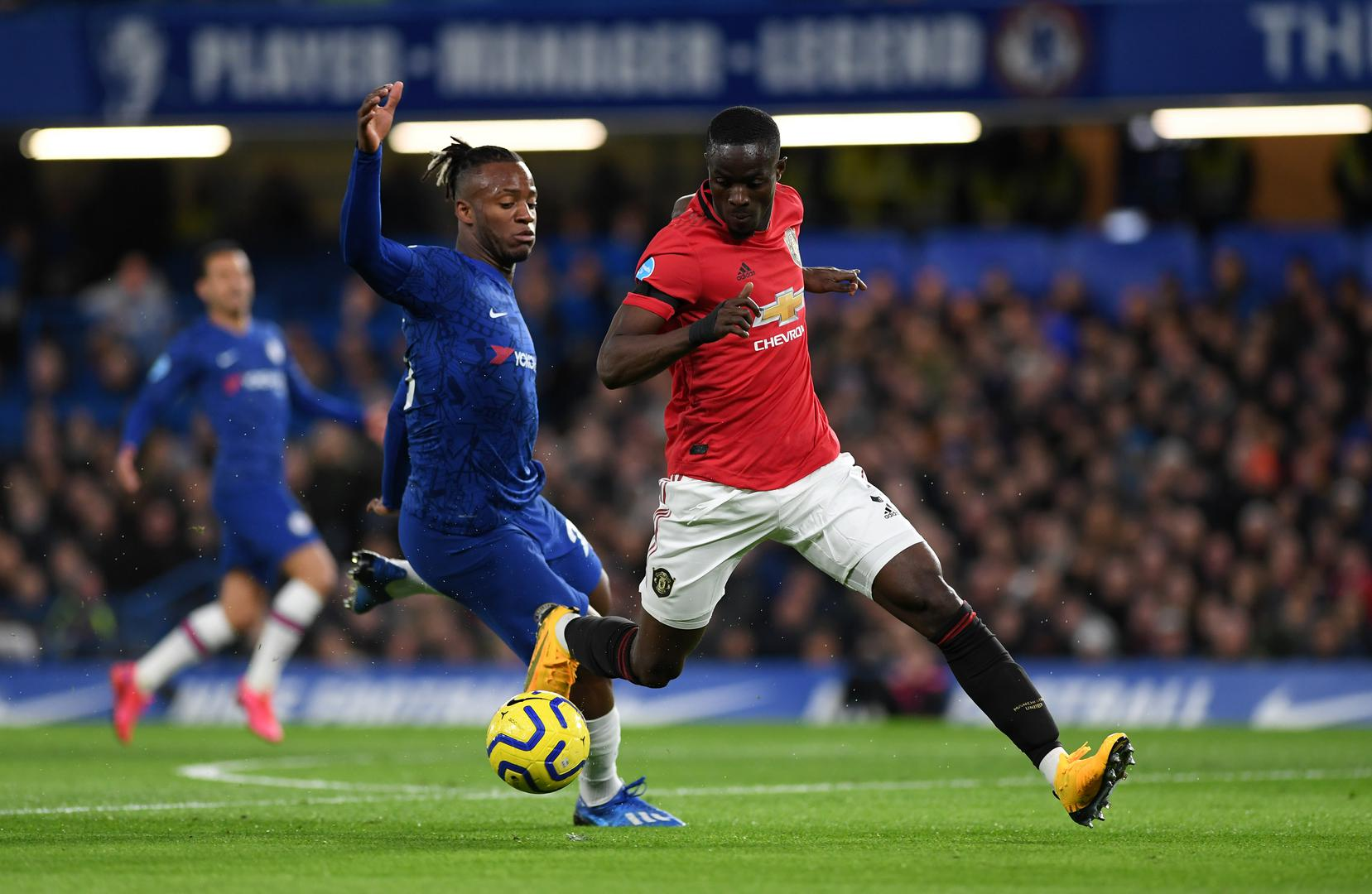 Eric Bailly makes a challenge at Stamford Bridge.