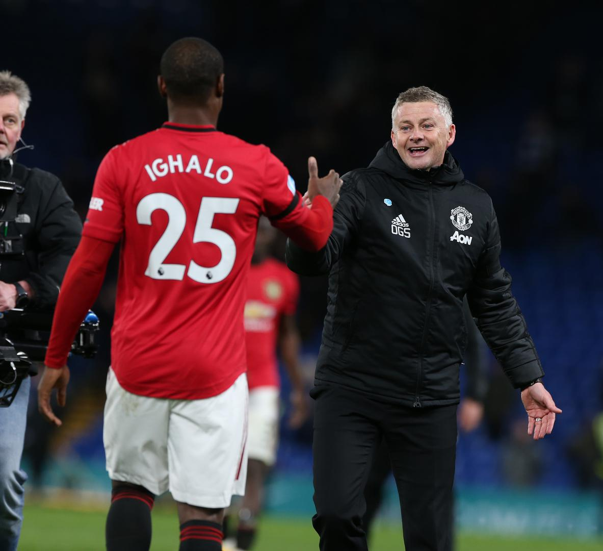 Odion Ighalo and Ole Gunnar Solskjaer celebrate United's win at Chelsea