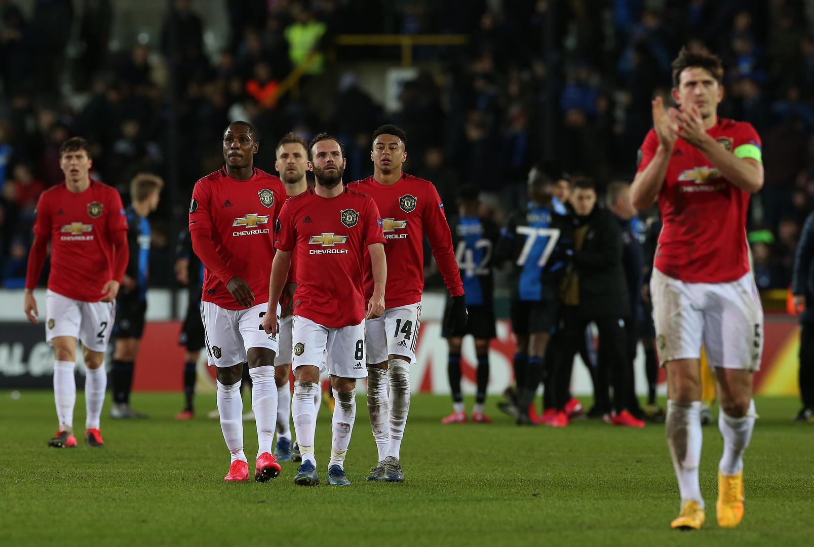 Juan Mata, Odion Ighalo, Jesse Lingard and Luke Shaw walk off the pitch after Manchester United's 1-1 draw with Club Brugge