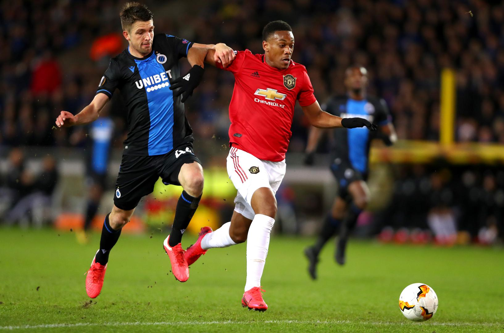 Anthony Martial surges past a Brugge defender to score Manchester United's equaliser in the Europa League
