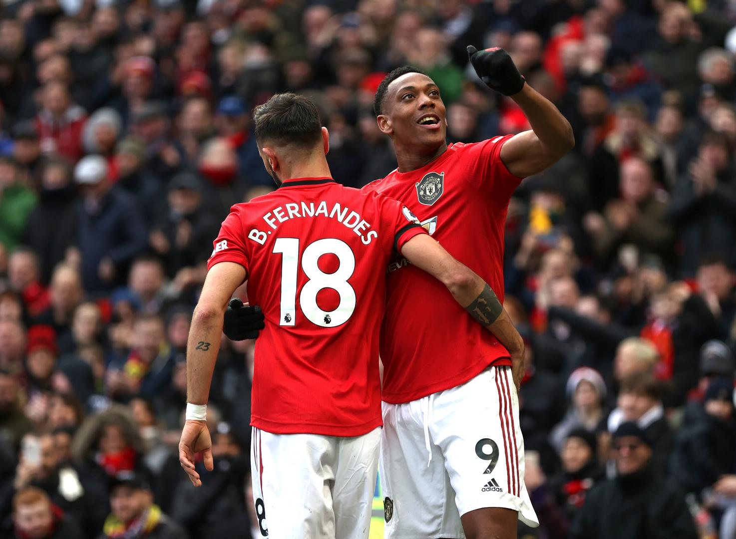 Anthony Martial celebrates with Bruno Fernandes