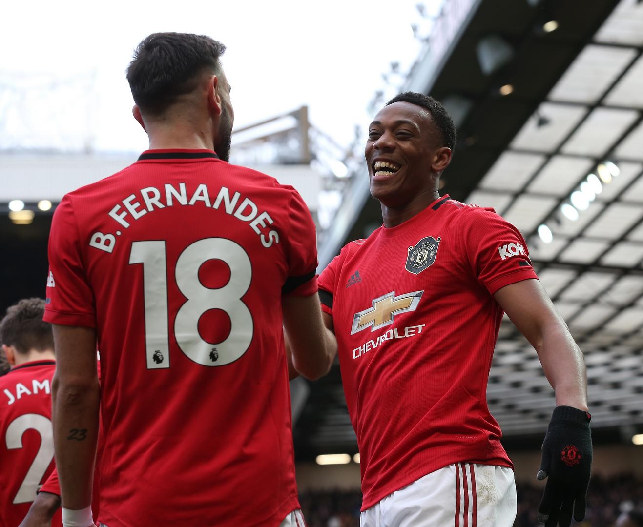 Anthony Martial celebrates a goal with Bruno Fernandes