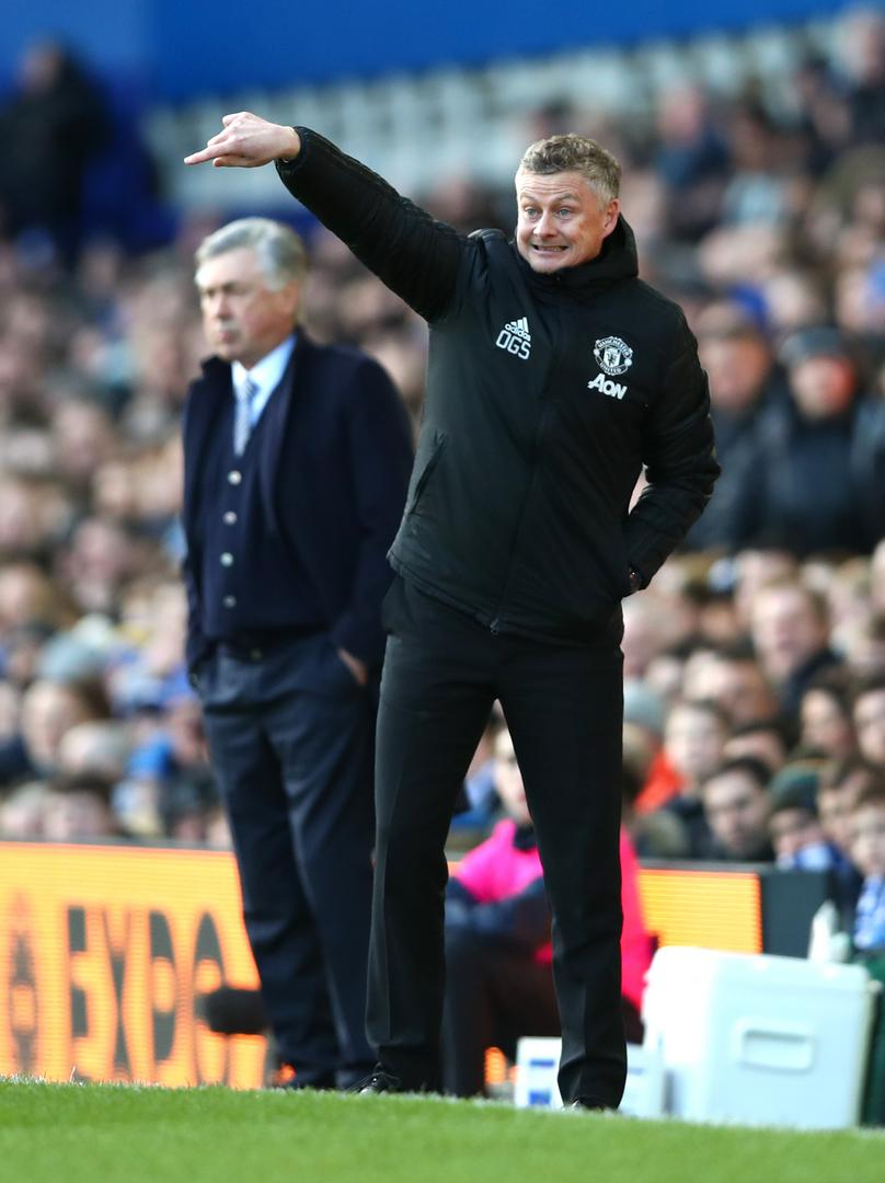 Ole Gunnar Solskjaer instructs his players as Carlo Ancelotti watches on.