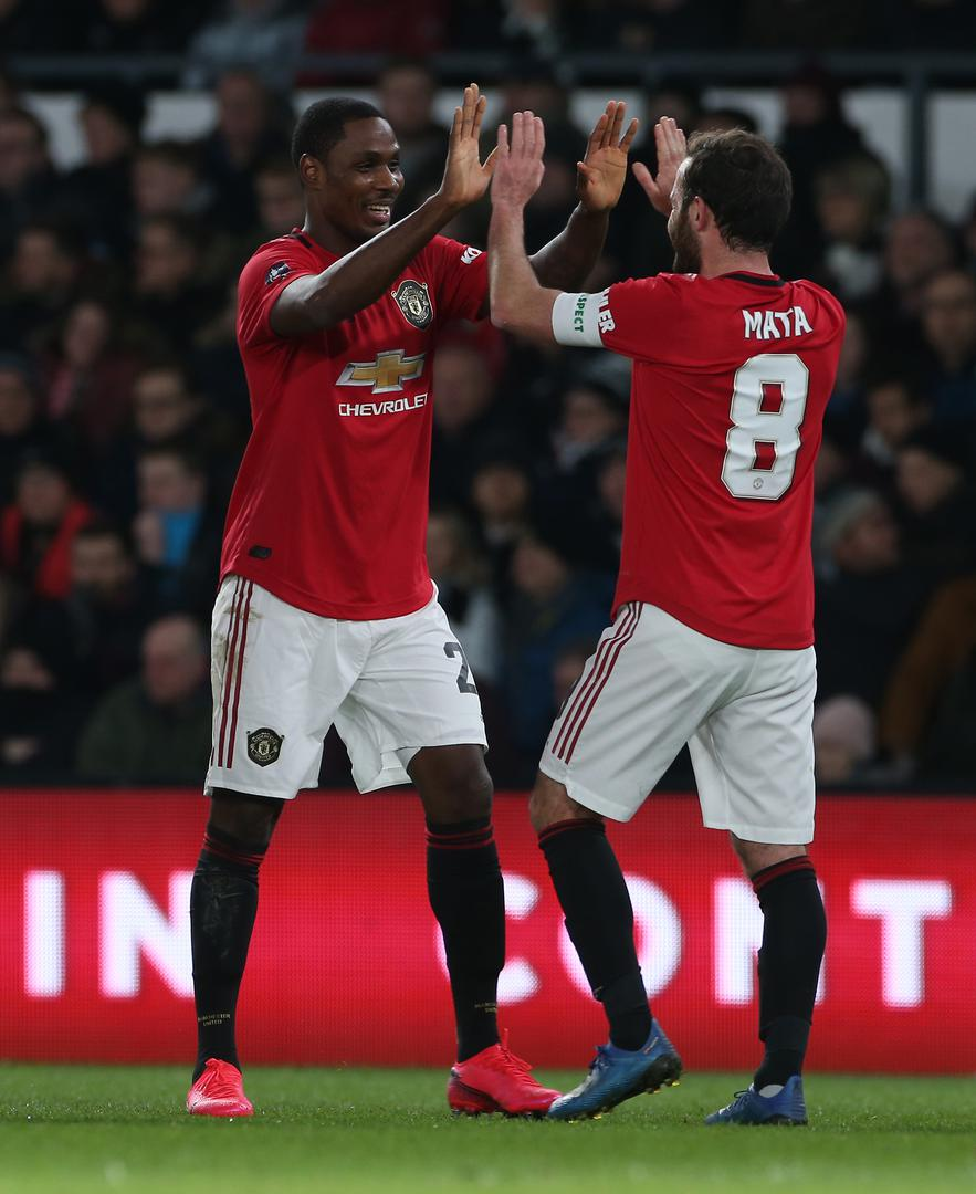 Odion Ighalo celebrates with Juan Mata