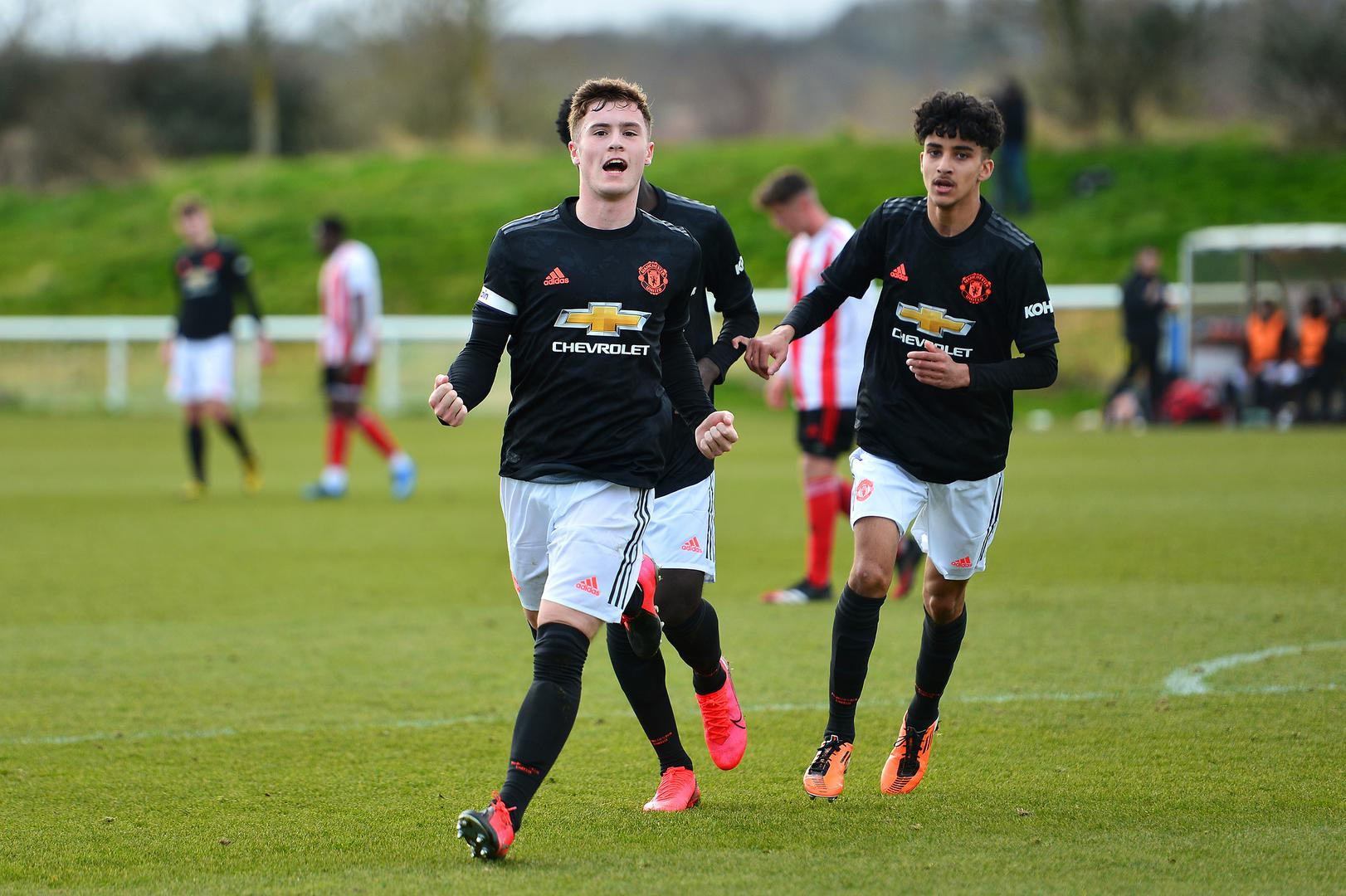 Charlie McCann celebrates after scoring for Manchester United Under-18s against Sunderland