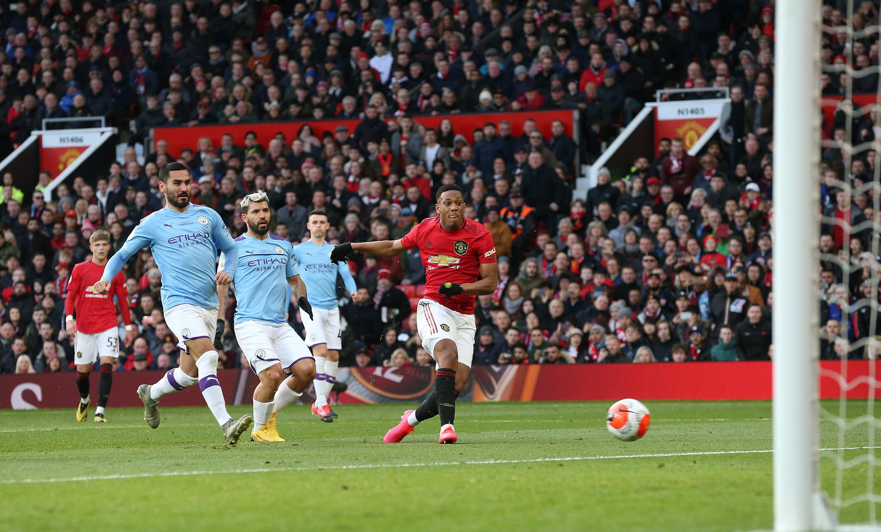 Anthony Martial scores against Manchester City.