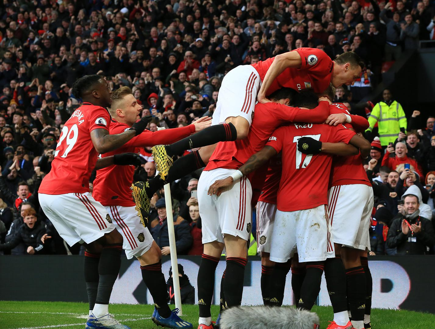 United celebrate Anthony Martial's goal.