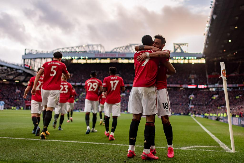 Bruno hugs Martial.