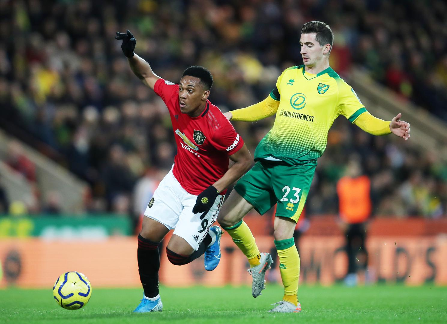 Anthony Martial is challenged by Norwich City's Kenny McLean