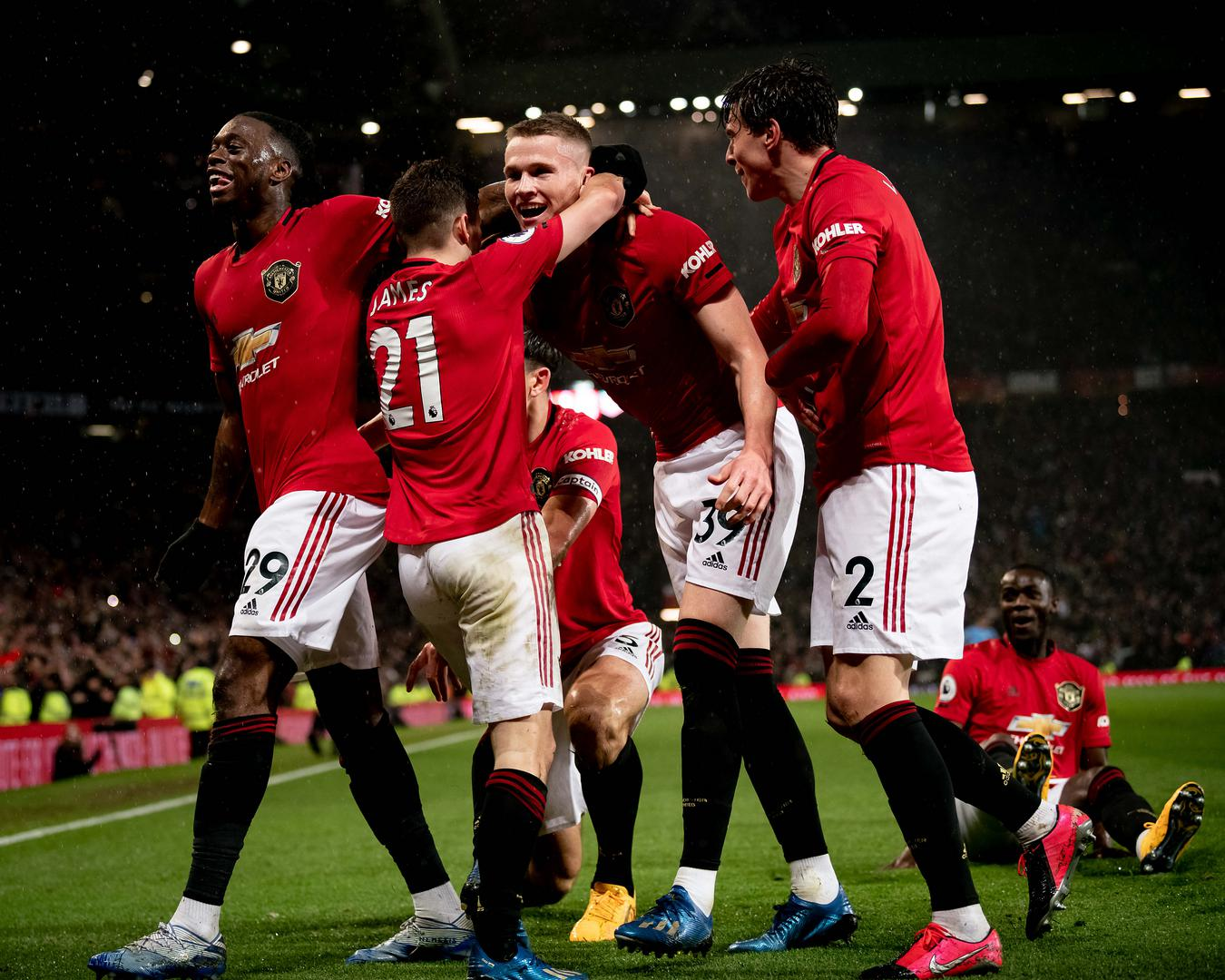 Manchester United celebrate after scoring against Man City