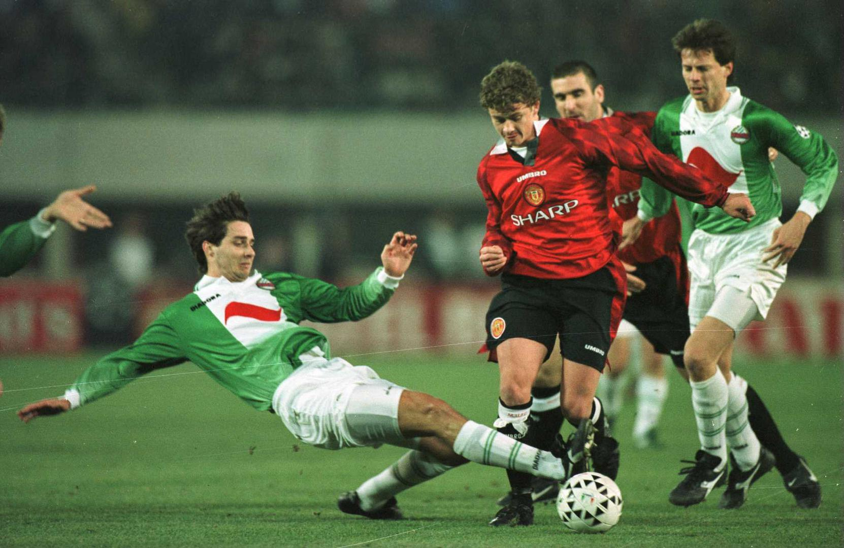 Ole Gunnar Solskjaer is tackled during a Rapid Vienna match