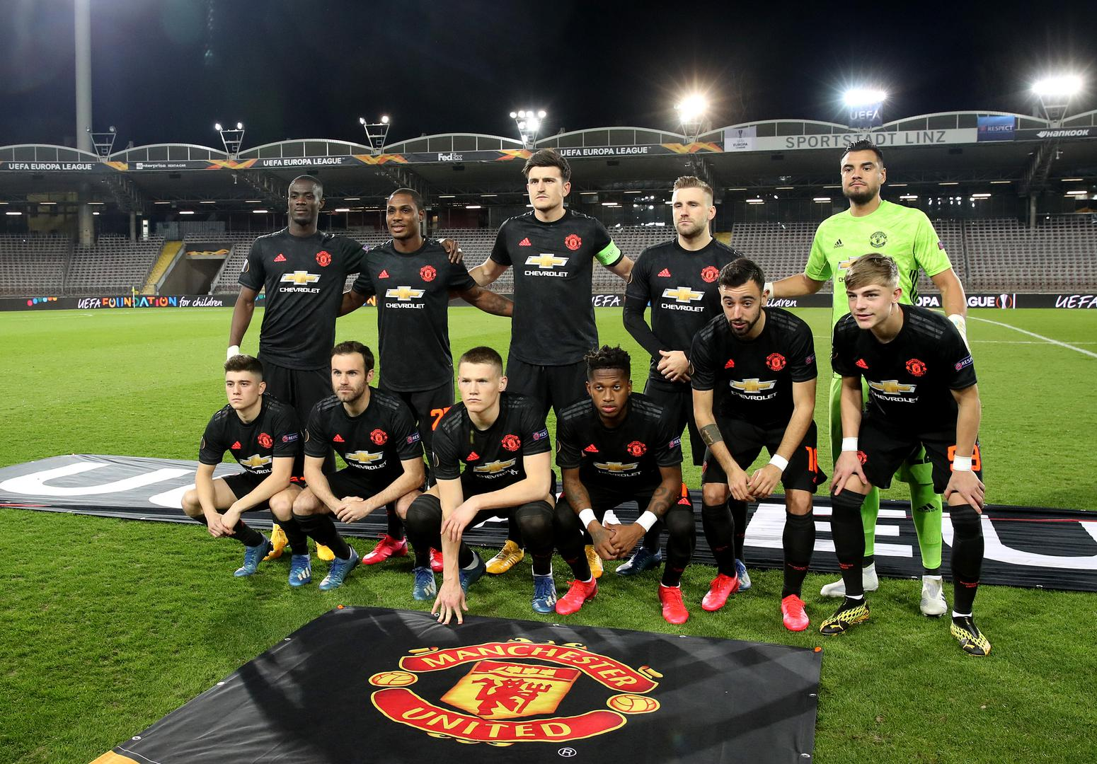 Manchester United players line up before kick-off against LASK