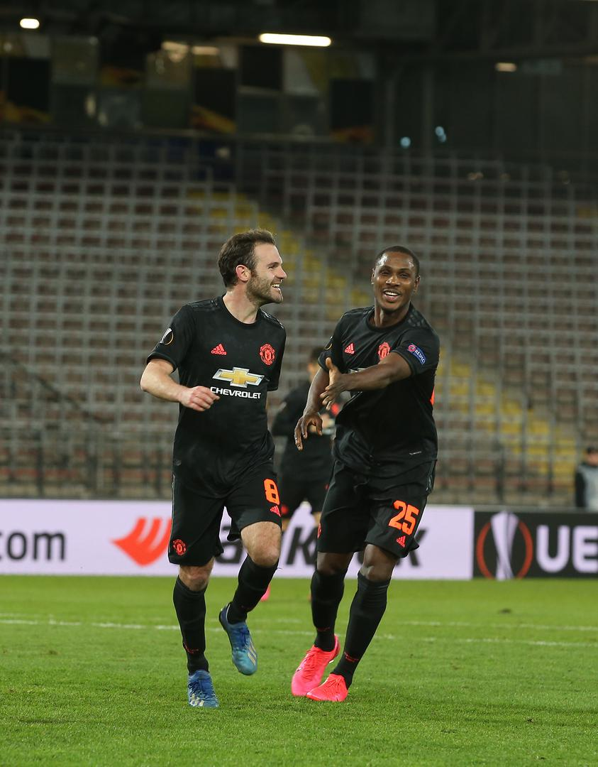 Juan Mata celebrates his goal against LASK with fellow scorer Odion Ighalo