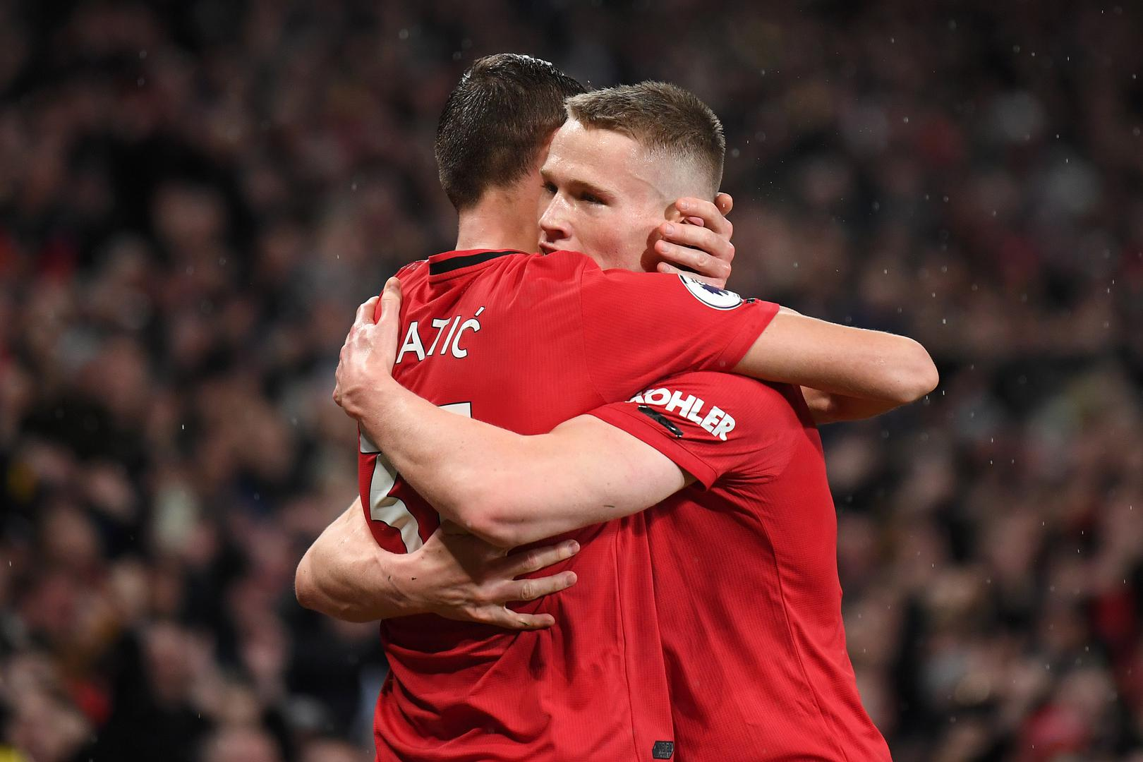 Nemanja Matic hugs Scott McTominay.