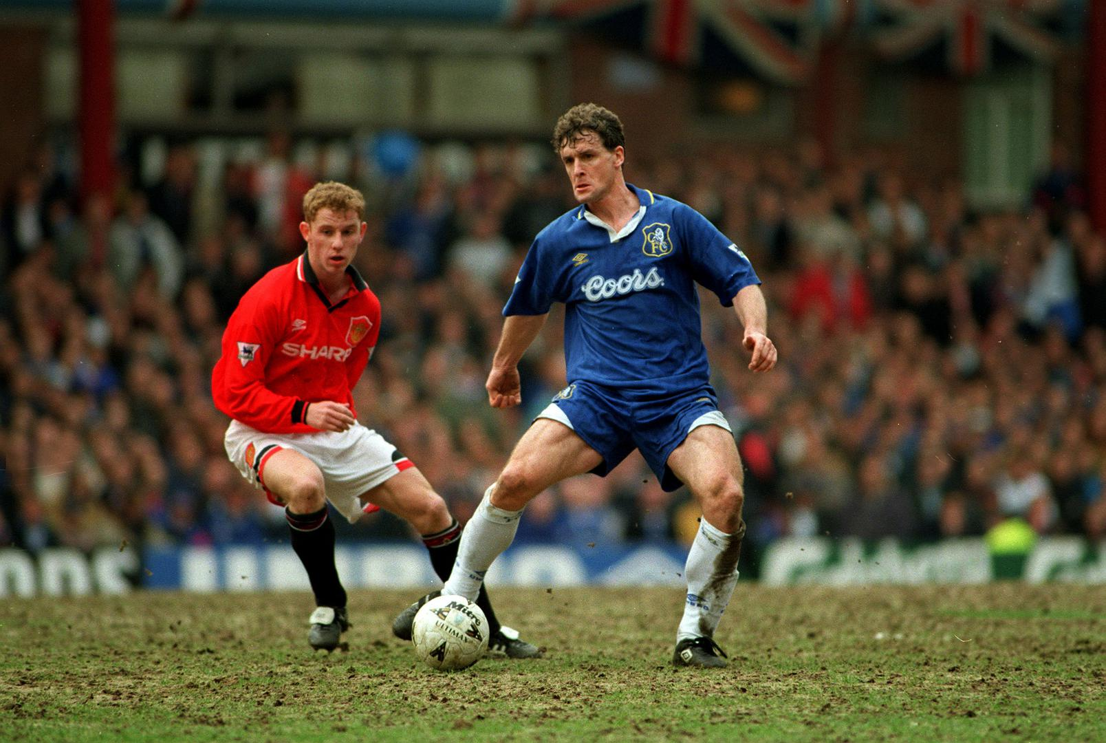 Nicky Butt in action for Manchester United against Mark Hughes of Chelsea.
