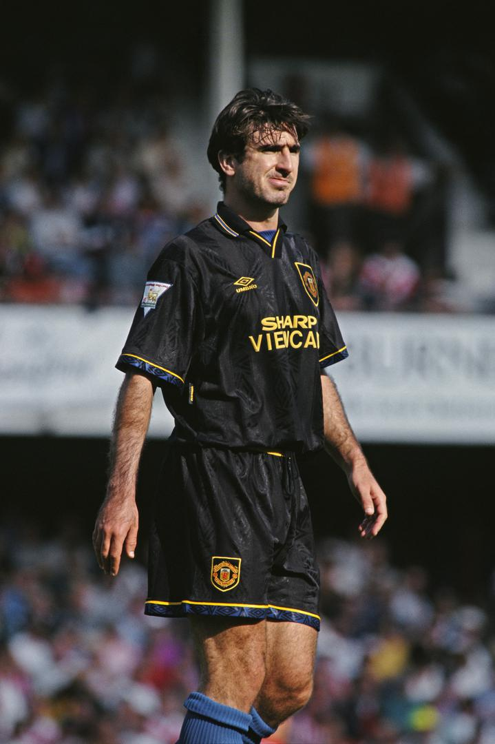 Eric Cantona in the black Manchester United kit for a match at Southampton in 1993/94