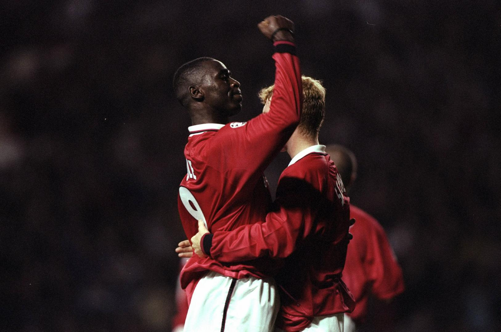 Andy Cole celebrates a goal against LKS Lodz in 1998.