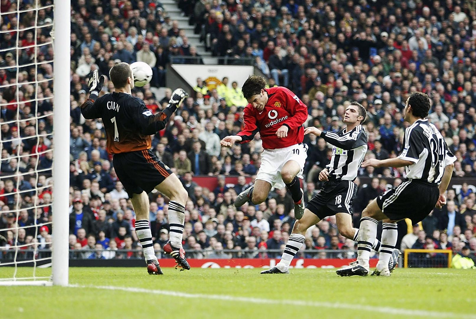 Ruud van Nistelrooy scores a header against Newcastle